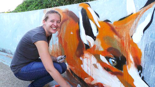Hannah Adamaszek painting one of her beautiful foxes